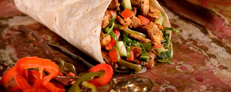 This Trinidad Chicken Roti recipe is great for those who love Caribbean flavours. It is simple to make and totally delicious! What You'll Need: Chicken Marinade • 600g deboned and skinless chicken thighs cut into bite-sized pieces • ½ teaspoon white pepper • ½ teaspoon dried thyme • 1 teaspoon crushed garlic • ½ teaspoon salt • ½ teaspoon curry powder • ½ teaspoon chicken stock Chicken Roti • Canola or Olive oil for cooking • 1 large onion, diced • 2 teaspoons crushed garlic • 1 ½ teaspoons of fresh or dried thyme • 1 ½ teaspoons smoked paprika • 1 teaspoon cumin spice • 1 teaspoon ground allspice • 2-3 tablespoons curry powder (depending on your taste) • 1 teaspoon ground nutmeg • 1 can chickpeas, drained • 1 tablespoon chicken stock • 2 cups cubed potatoes • ½ - 1 teaspoon cayenne pepper (optional) • 1 teaspoon white pepper • 3-4 cups chicken stock or water • Salt to taste • Anat roti's How to Make the Roti's? 1. Place your chicken in a large bowl and add your garlic, thyme, salt, white pepper and curry powder. 2. Mix the chicken with a spoon or with your hands until all the pieces are well coated. Set this aside in the fridge and allow it to marinade for at least 30 minutes. If you can leave it for longer or overnight, the flavor is even better. 3. When you are ready to cook, heat up your oil a large saucepan and add your onion, garlic, thyme, cumin, allspice, smoked paprika, nutmeg and your curry powder. Stir occasionally for about 3-4 minutes until your onions are translucent. 4. You are now ready to add your chicken. Once added, stir and sauté this for about 2-3 more minutes. Add your chicken stock or water if necessary, to prevent anything from burning. 5. Next, add your chickpeas, chicken stock, cayenne pepper, white pepper and potatoes. Bring the mixture to the boil and let it simmer until the sauce thickens. This takes 20-30 minutes. 6. Add salt and pepper to taste. Once ready, fill your Anat roti's with the mixture and enjoy!